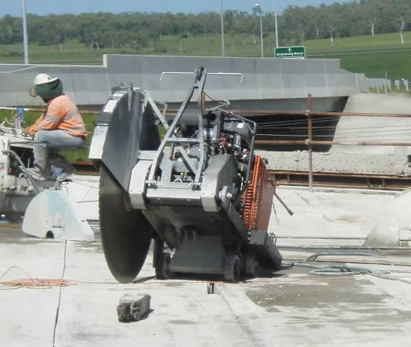 Floor sawing bridge for removal