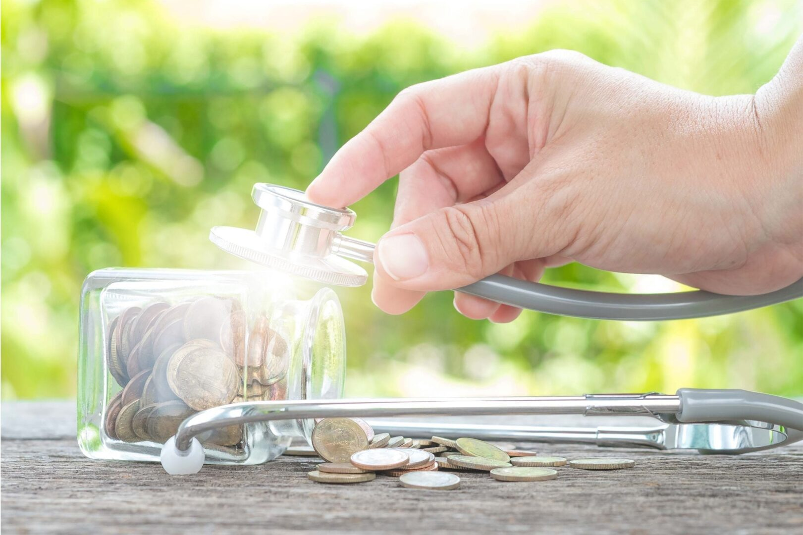 Second Opinion Service Mackay - Stethoscope against glass jar of coins to indicate checking financial health